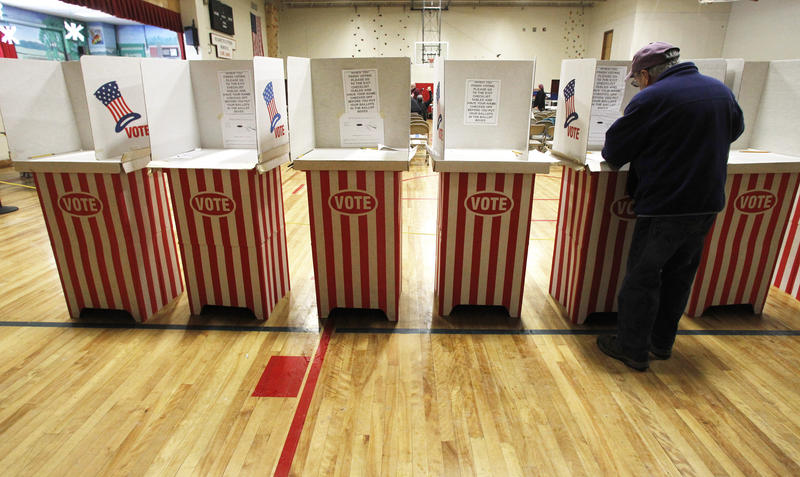 A voter casts his ballot in 2013 in Hardwick.