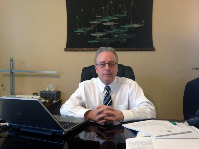 "State Auditor Doug Hoffer, shown here in his office in November, 2014,  says Vermont isn't doing enough to stop a practice known as ""misclassification"" of workers."