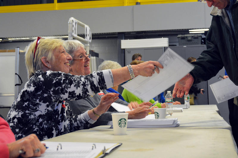 Sue Powers and Sally Metro hand out ballots at the Williston Armory on Tuesday afternoon.