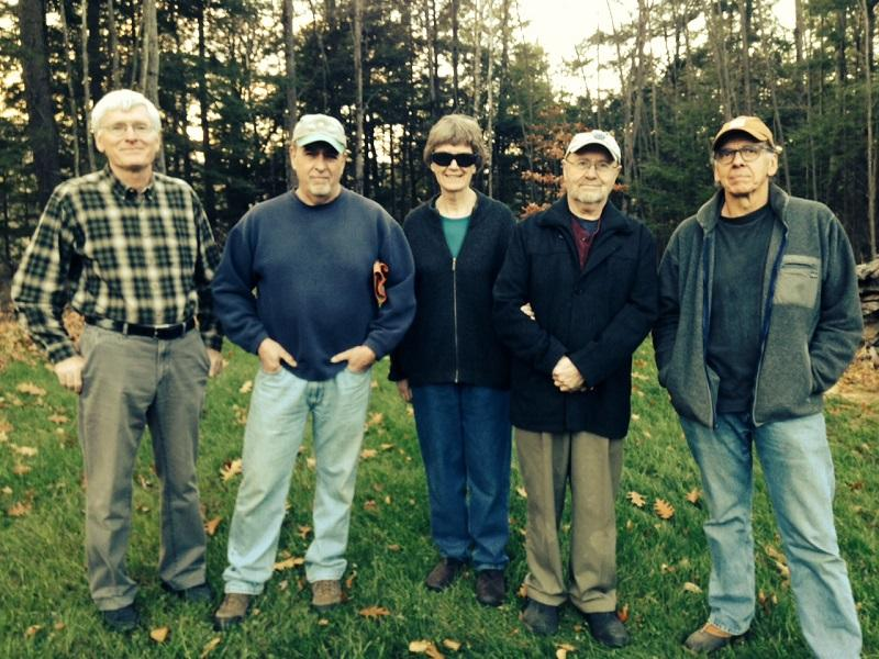 John Bartholomew, of Hartland, joins Dan Dewey, Irene Daigle, Jim Daigle, and Ron Eberhardt in Dewey's New Hampshire backyard. At issue is whether a shooting range 300 yards across the Connecticut River, in Vermont, is too noisy.