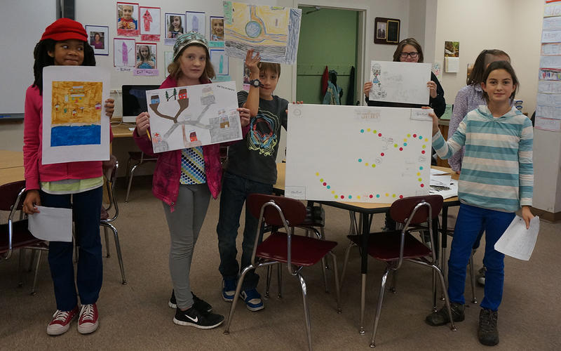 Students from the Cabot School show off some of the DCF Quest Club projects that have earned them points and badges.