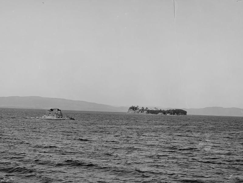 Rock Dunder, on the left, can be seen from the shore of Lake Champlain in Burlington. Also known as Oodzee-hozo, the tiny island has a deep significance in Abenaki mythology.