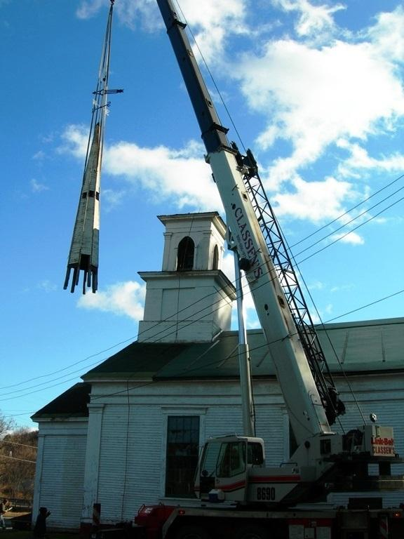 A crane aids repairs to a steeple that had threatened to fall from the York Street Meeting House, once home of the First Congregational Church in Lyndon.