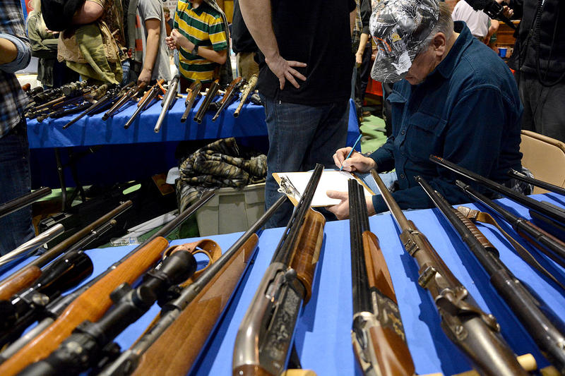A customer fills out a background check form at the 2014 Barre Gun Show. Leaders in the Vermont Senate are proposing further gun-control legislation with more restrictions, focusing on those convicted of violent crimes.