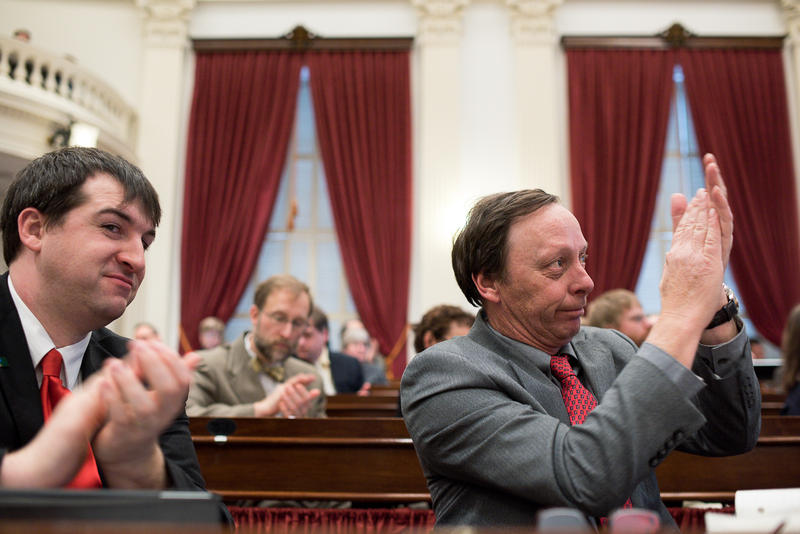 Rep. Paul Dame, left, R-Chittenden, and Joey Purvis, right, R-Chittenden, react while Gov. Peter Shumlin delivers his budget address on Jan. 15 at the Statehouse. Republicans don't think that businesses can afford the new payroll tax Shumlin proposed.