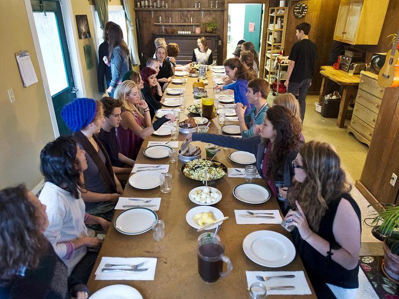 Students, faculty and guests at Central Vermont High School Initiatve in Plainfield gather for a community meal that the students have preapred.