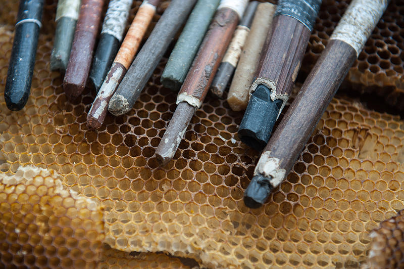 These handcrafted crayons, made from beeswax, are just some of the art supplies Montpelier artist Nick Neddo creates from materials he forages for in the woods.
