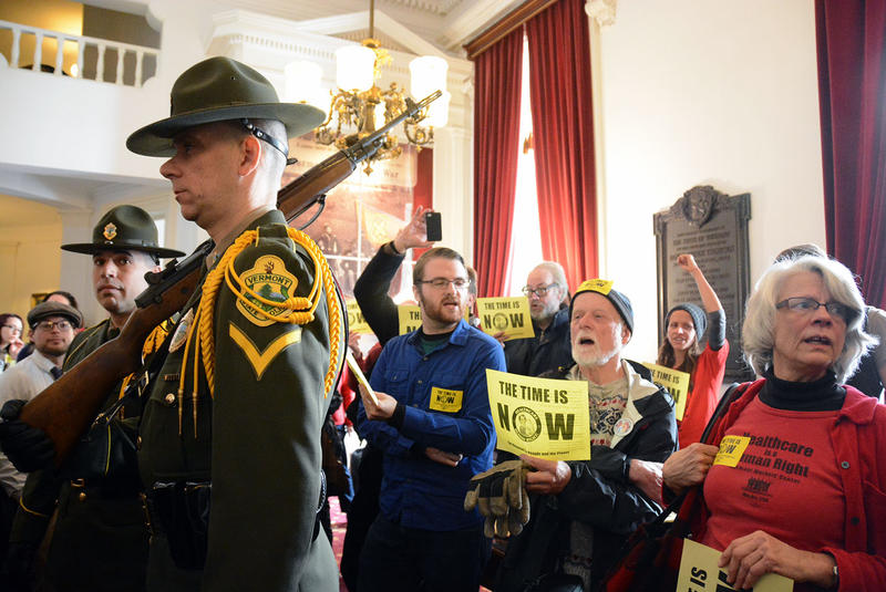 Protesters in favor of single payer crowded the hallway outside the House Chamber ahead of Gov. Peter Shumlin's inaugural address on Thursday afternoon.
