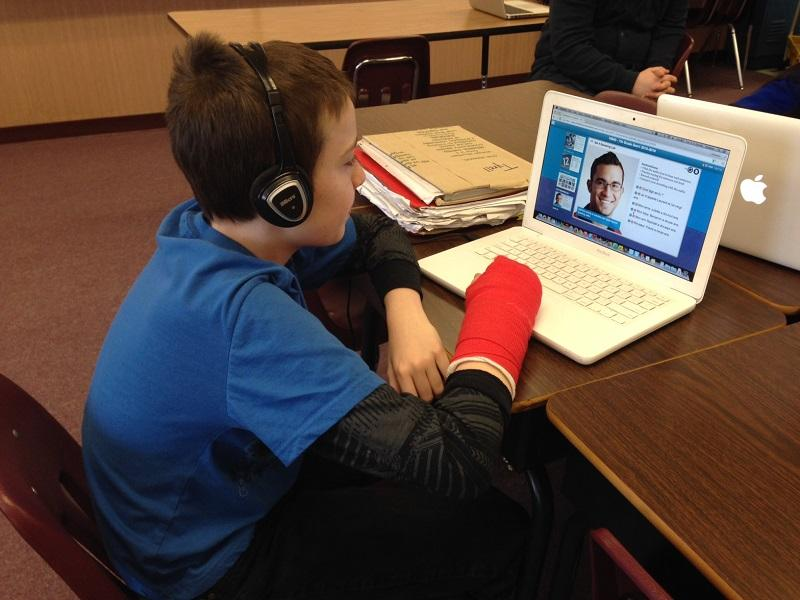 Tyrell Dowland learns how to count in French through an online class at Coventry School.
