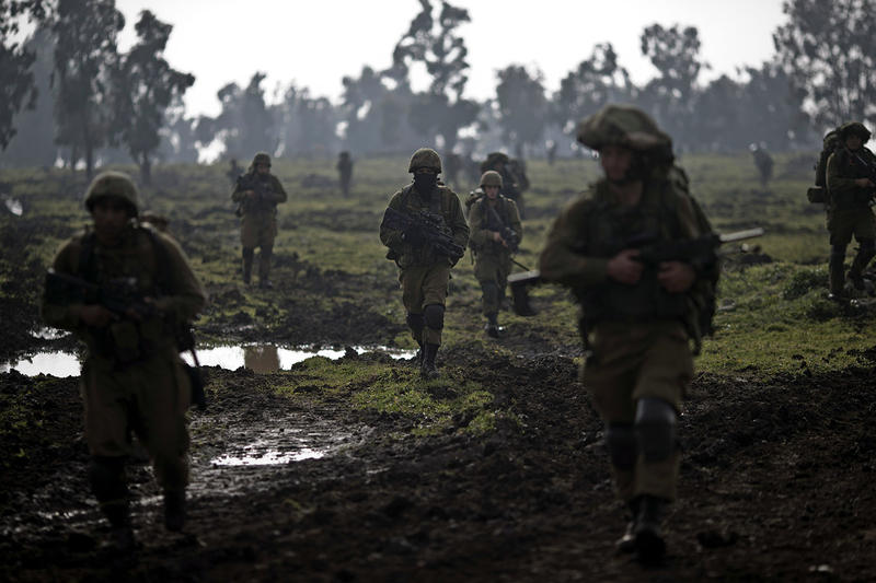 Israeli soldiers train near the Israel-Syria border on Jan. 19. A military think tank based in the U.S. is paying close attention to the destabilizing effects of climate change, such as a widespread drought that helped precipitate Syria's civil war.