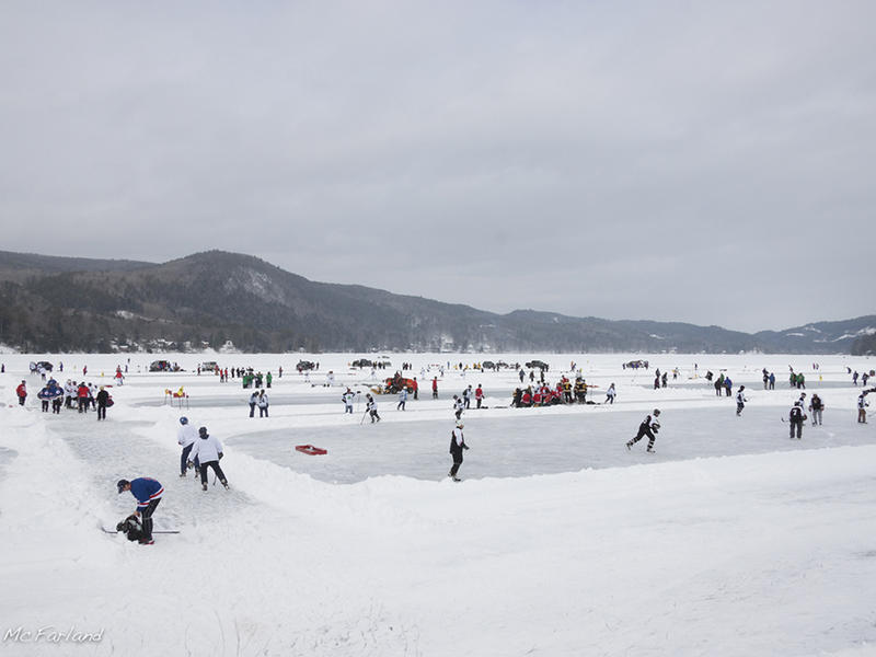 A pond hockey tournament was one of the activities happening on top of Lake Morey during biologists Sarah Zahendra and Kent McFarland's visit. They explored both the activity on top and below the ice in the winter months.