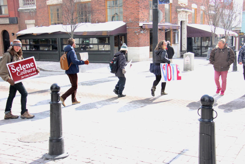 Students made their way to Burlington's city hall Wednesday, carrying signs encouraging voter turnout.