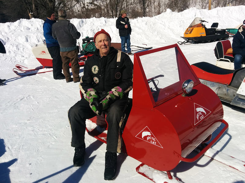 Marcel Smith, 90, of Barre shows off his small, half-century-old Arctic Cat, which bears an inscription of his late wife Ruby. Most of Vermont's antique snowmobiles are now in museums, but some that aren't are on display at this gathering in Bethel.