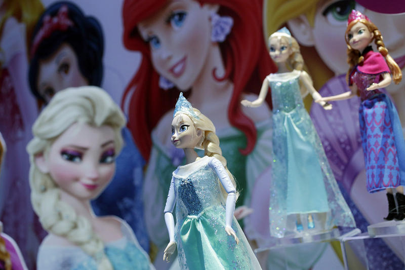 "A Mattel toy booth displays dolls from the Disney feature ""Frozen"" in New York in 2014. While Disney is known for its ""love at first sight"" plots, SUNY Plattsburgh professor Connie Shemo thinks that it's starting to re-imagine the idea of fairytale love."