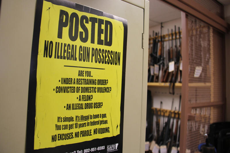 A poster in the evidence locker at the Burlington office of the Bureau of Alcohol, Tobacco, Firearms and Explosives outlines federal rules that Vermont legislation is aimed at mimicking.