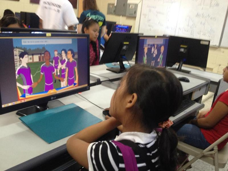 A girl in El Salvador plays Breakaway, a game from Champlain College's Emergent Media Center designed to tackle issues of gender equality.