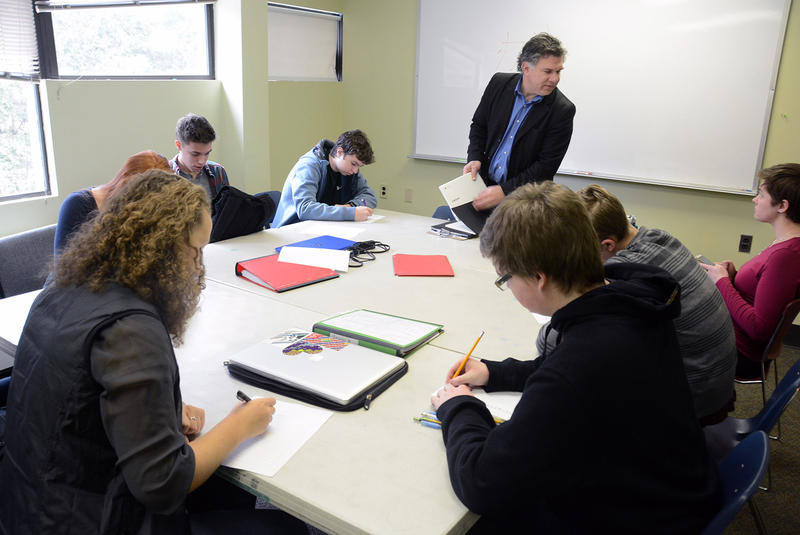 Dexter Mahaffey, head of the Vermont Commons School in South Burlington, subs in a Chinese class on March 20. Between 10 and 20 percent of the school's students come from school choice towns that contribute tuition.