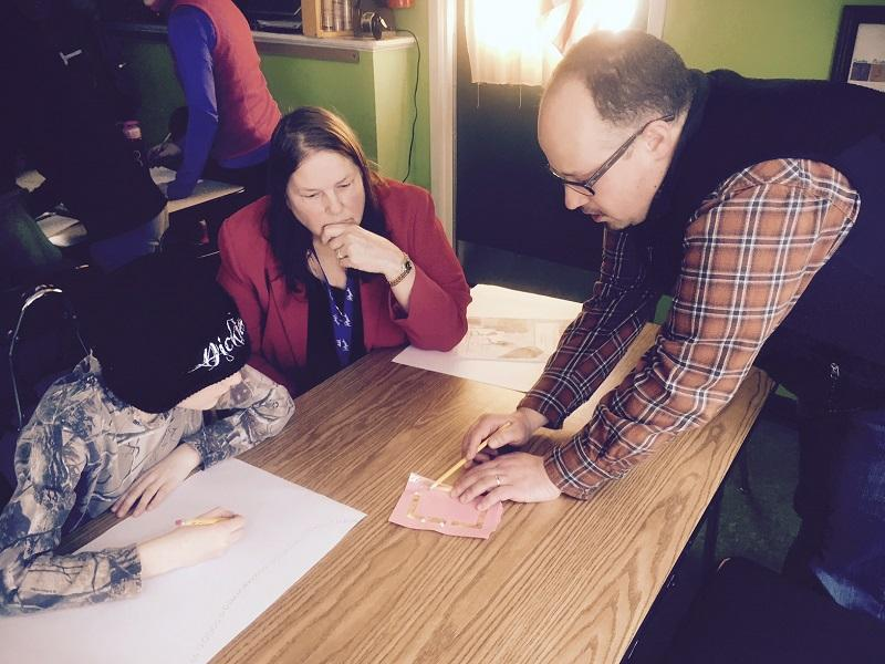David Schilling and Gail Curtis help a student at Cabot School figure out how to create an electric circuit with conductive tape. Cabot is one of the small schools in Vermont facing consolidation and budget cuts with proposed legalization this year.