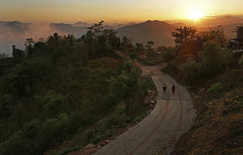 The sun sets over the destroyed village of Paslang village near the epicenter of Saturday's massive earthquake in the Gorkha District of Nepal. Many Vermonters with ties to Nepal are coming together to help with relief efforts in any way they can.