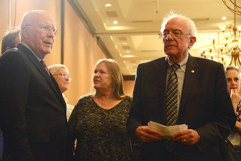 Sen. Patrick Leahy, left, and Sen. Bernie Sanders, pictured here in Nov. of 2014 at the Democratic Headquarters in Burlington, both oppose a plan to give Pres. Obama streamlined authority to enter into the Trans-Pacific Partnership.