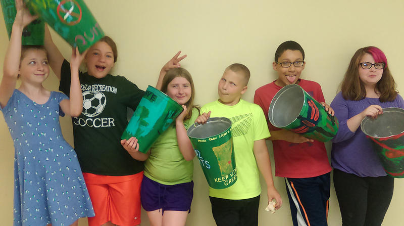 Windsor VKAT members show off the tobacco litter buckets they decorated to help keep their town clean.