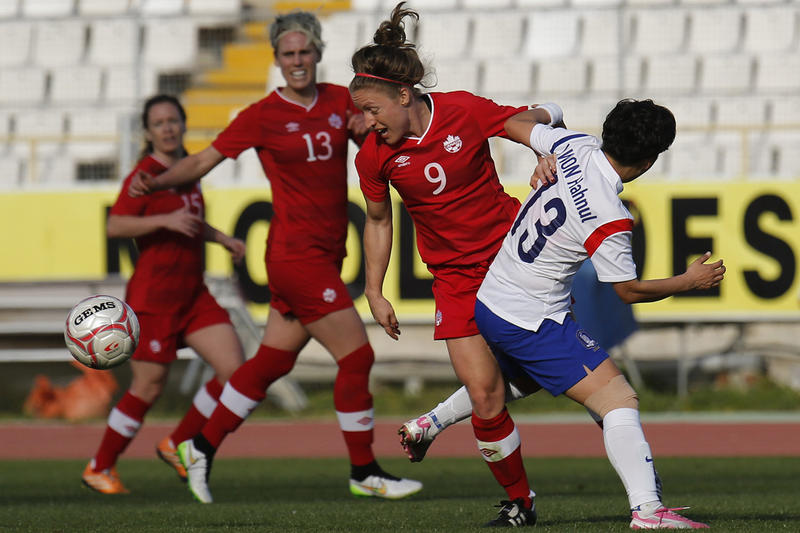 Canada's Josee Belanger, center, fights for the ball during the Cyprus Women's Cup soccer match in March. The Quebec native is competing with Canada's national women's team in the 2015 FIFA Women's World Cup in her home country.