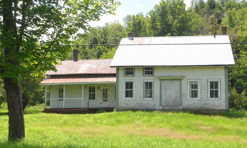 This historic Bolton farmhouse is being sold by the state of Vermont. The minimum bid for the house and 30 acres is $80,000, down from $126,000.