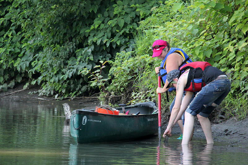 Keurig Green Mountain employees had to use a shovel to pry an old backpack off the bottom of the Winooski River in Waterbury. Big Vermont businesses are using their deep pockets and other resources to improve Vermont's waterways.