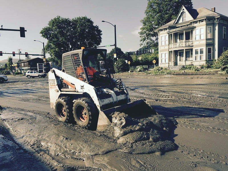 Crews attempt to clear the mud from North Main Street in Barre on Monday after storms dumped 3.5 to 4 inches of rain on central Vermont.