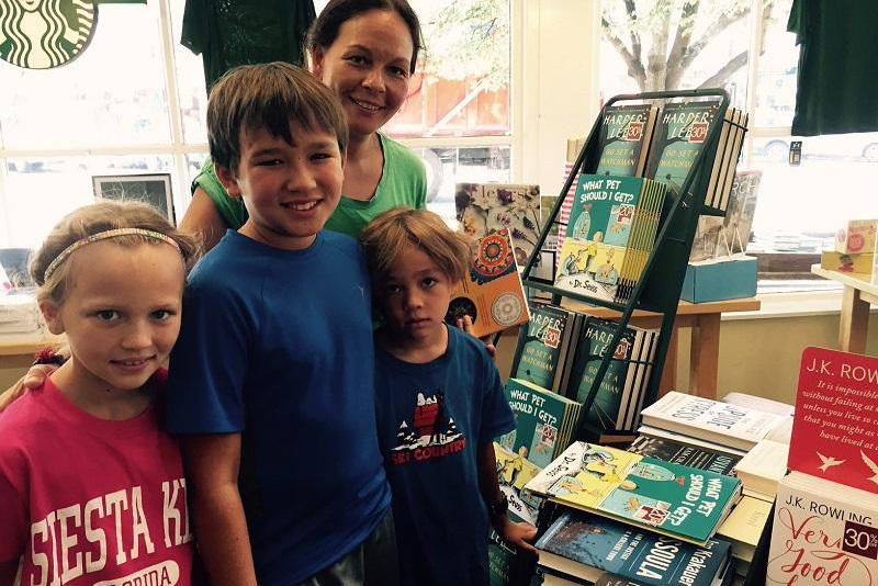 "Tracy Curry and her children Sophie, Ian and Luke pause in front of the display of the Dr. Seuss book, ""What Pet Should I Get?"" at the Dartmouth bookstore."