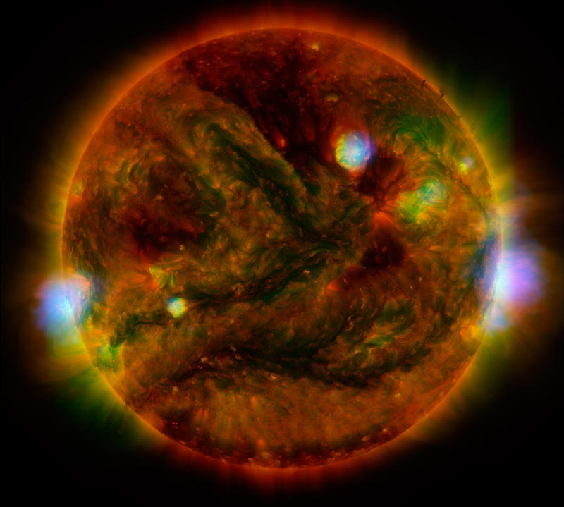 Flaring, active regions of our sun are highlighted in this new image combining observations from several telescopes. The active regions across the sun's surface contain material heated to several millions of degrees.