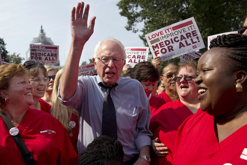 Sen. Bernie Sanders waves after speaking at a rally with registered nurses and other community leaders celebrate the 50th anniversary of Medicare and Medicaid on Thursday in Washington, D.C. A poll shows Sanders gaining ground in the presidential race.