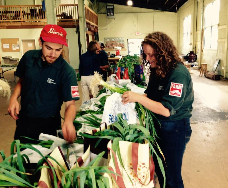Vermont Youth Conservation Corps crew leader Connor Magnuson works with employee Tessie McDonnell to fill 75 grocery bags for a new pilot program in Rutland that provides free produce to families at risk of obesity, diabetes and heart disease.