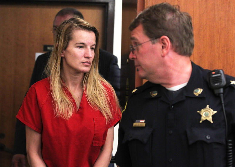 Jody Herring is led out of court after her arraignment in Vermont Superior Court in Barre on Monday, Aug. 10. The 40-year-old woman from Barre Town has pleaded not guilty to shooting and killing a DCF social worker on Friday.