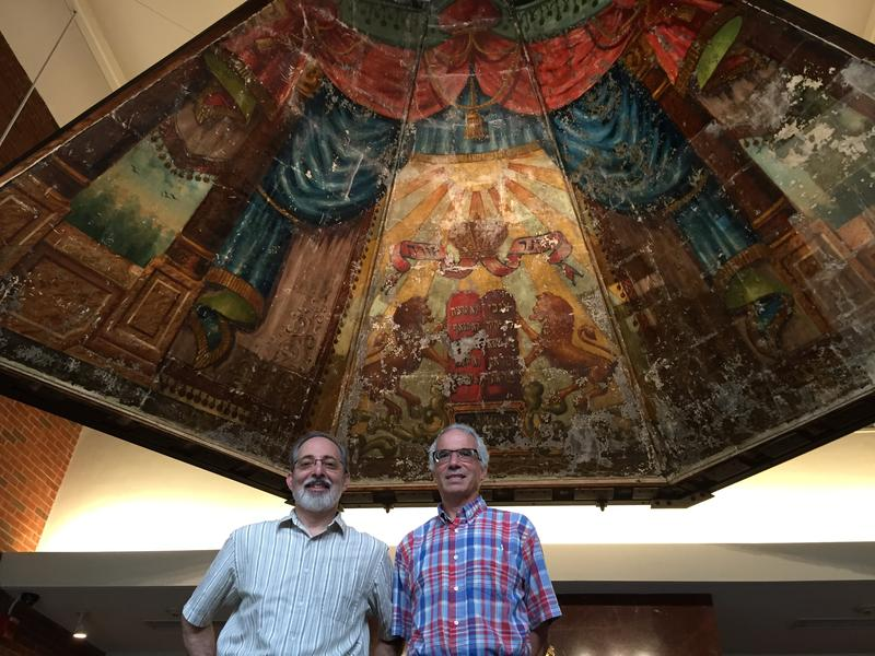 Aaron Goldberg and Jeffrey Potash stand beneath the mural they have spent years trying to preserve.