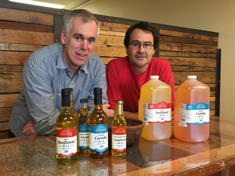 David McManus and Netaka White with the cooking oils their company Full Sun produces.