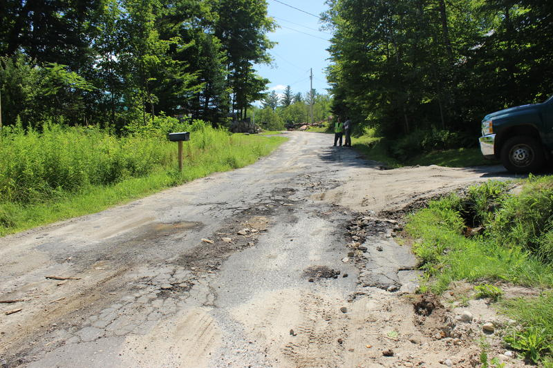 Ricker Pond is at the base of this crumbling road. Groton is working on reshaping the crown and putting in stone-lined ditches to filter sediment-laden runoff.