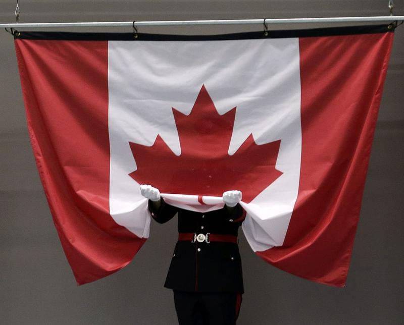A York Regional Police officer attends a Canadian flag in Markham, Ontario, July 2015.