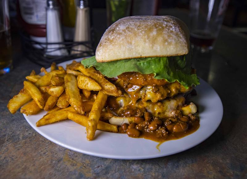 The Landmark Tavern's signature burger, which is topped with chili, onion rings, bacon and jalapeno peppers.