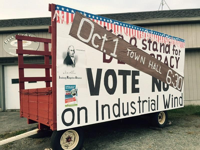 A mobile billboard urges Irasburg voters to cast ballots on a local wind project.