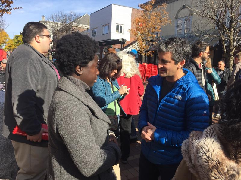 Mayor Miro Weinberger talks with Jocellyn Harvey, a woman who received a Klu Klux Klan image in her mail.