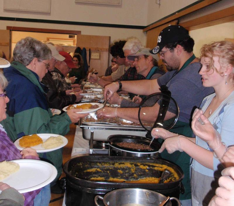 People go through the food line at the Tinmouth game supper. The supper raises enough money to outfit one firefight for a year.
