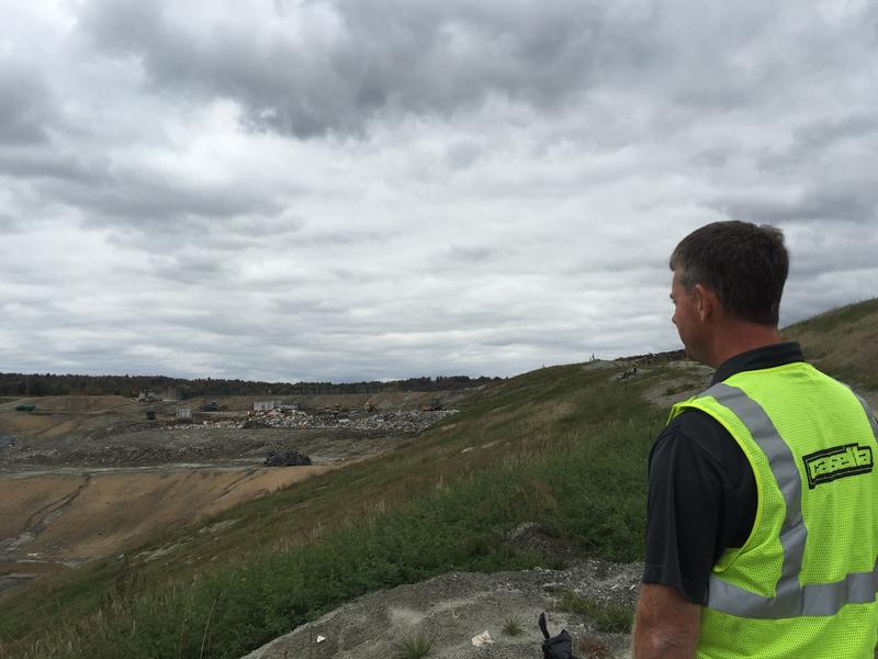 Joe Gay - an engineer with Casella Waste Systems - stands before the Coventry landfill.