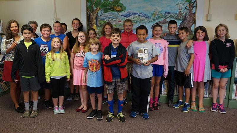 Fifth and sixth graders at Beeman Elementary School gather in the school library to learn about 'Under the Egg'.