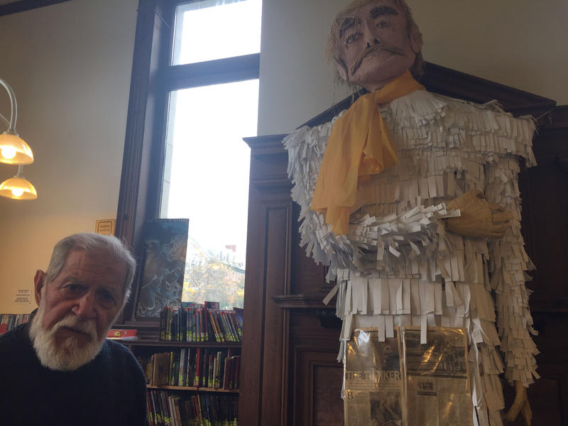 Artist and John Dewey enthusiast Frank Gonzalez sits beside the puppet he created in John Dewey's likeliness. Gonzalez is the organizer of Dewey Day, an annual celebration of philosopher John Dewey's birthday.
