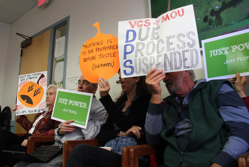 Advocates opposed to the Vermont Gas Addison County pipeline held up signs at Thursday's Public Service Board proceeding.