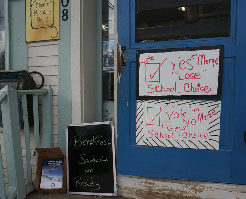 "A sign on the door of the Elmore Store explained what a ""yes"" and a ""no"" merger vote mean for school choice in Elmore."