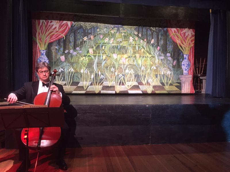 "John Dunlop, of the Vermont Symphony Orchestra, perfrom in front of the curtain, ""Spring,"" painted by Julia Zanes."