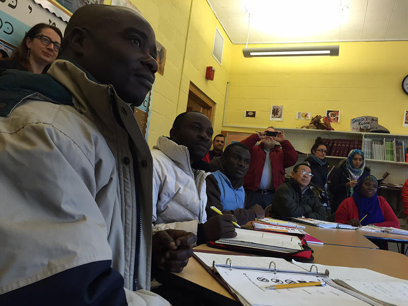 Ode Mbilize, far left, a refugee from the Congo, looks on as Gov. Peter Shumlin addresses his English class Tuesday. Shumlin visited the classroom in Burlington to reiterate his support for bringing Syrian refugees to Vermont.