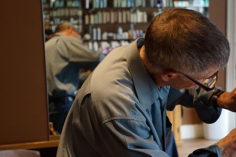 Vaughn Hood, a veteran of the Vietnam War, cuts hair in his St. Johnsbury salon.